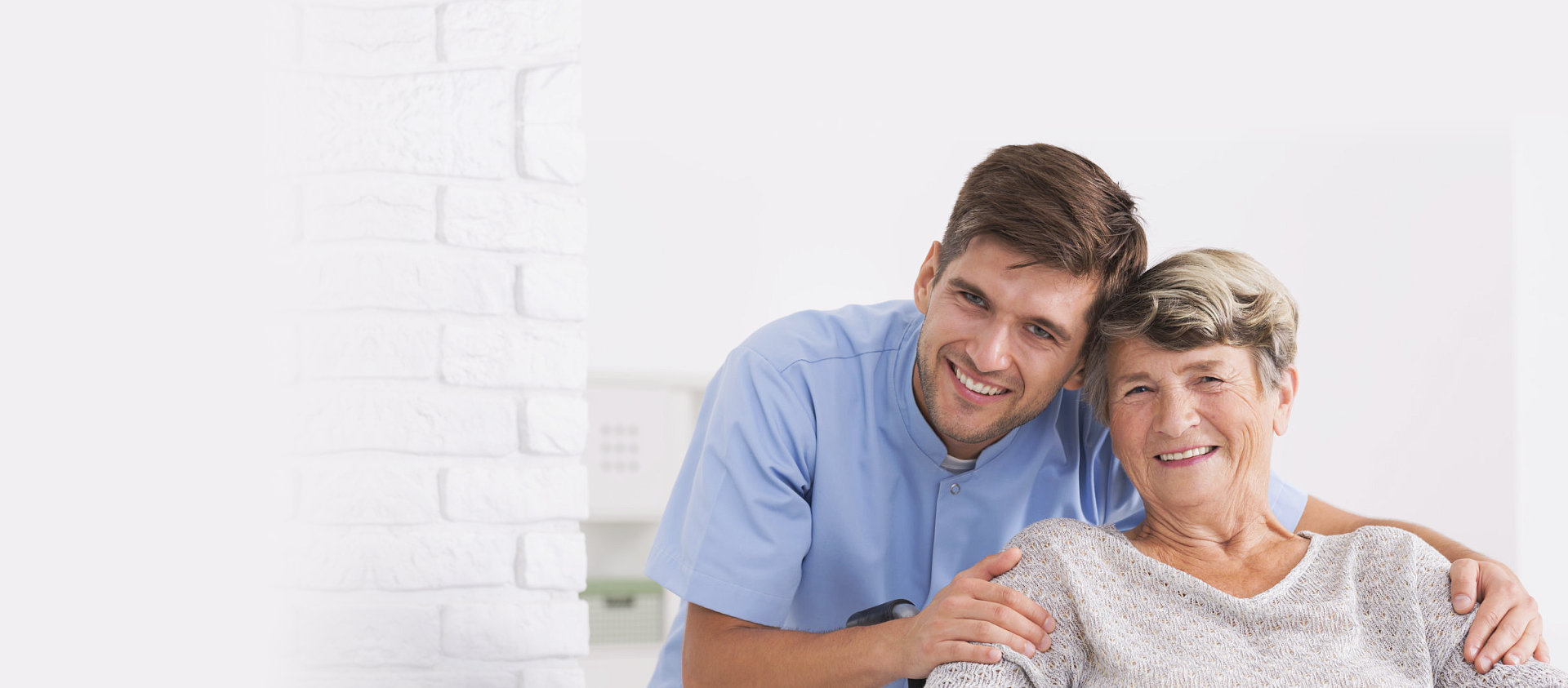 male caregiver and senior woman smiling